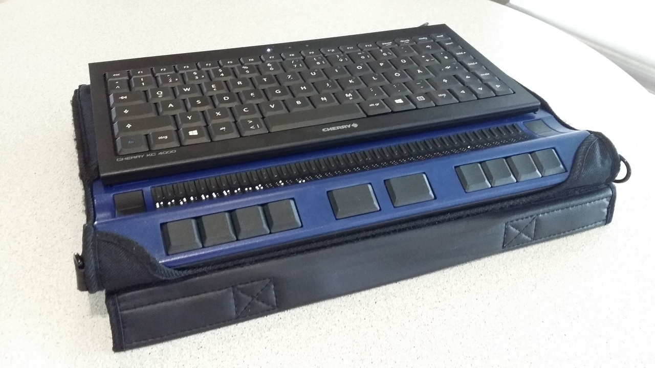 [picture: a braille display with a keyboard on top and a Raspberry Pi Zero inside]